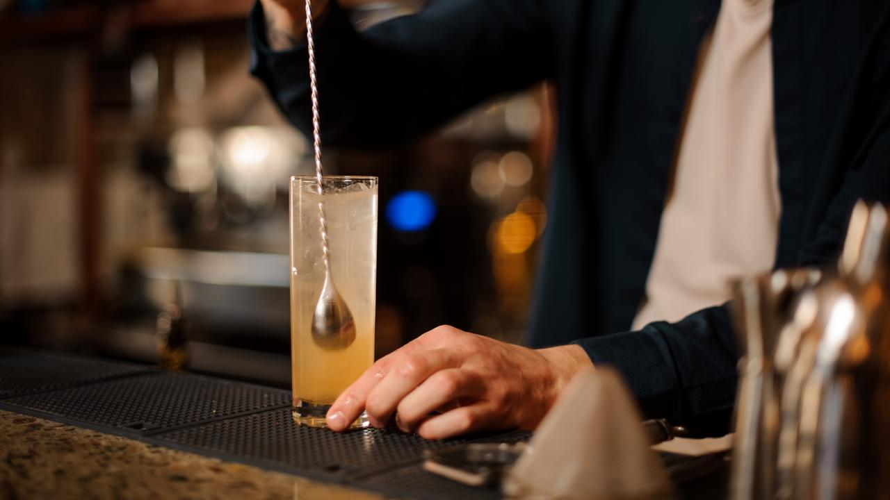 bartender stirring cocktail