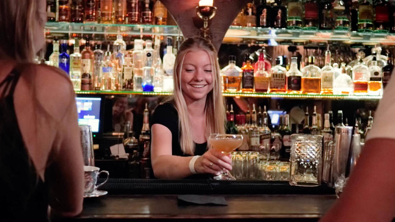 emma serving cocktail