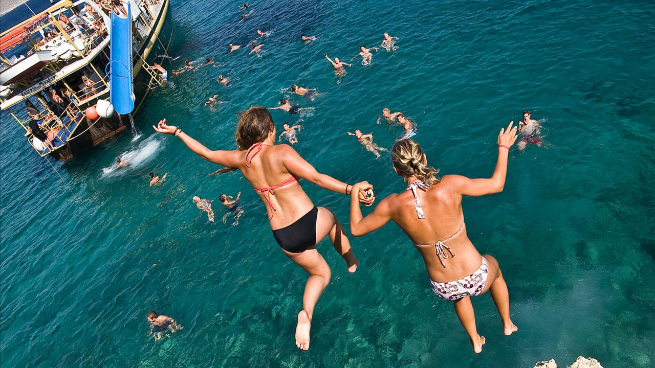 girls jumping boat