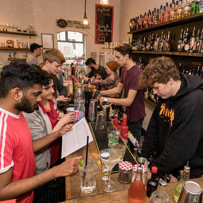 students practicing bartending in berlin