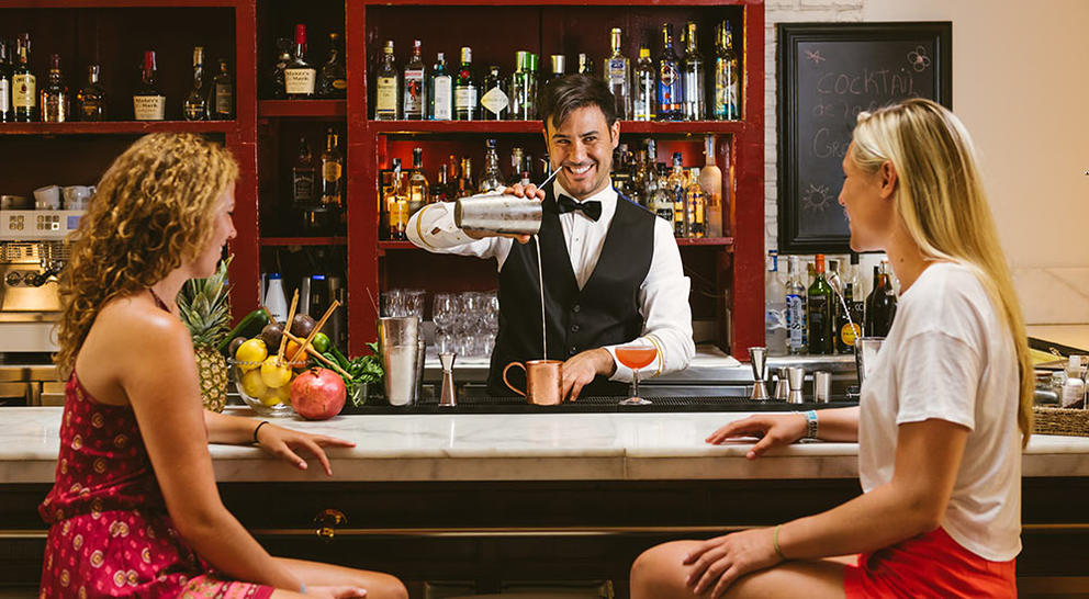 bartender smiling pour girls